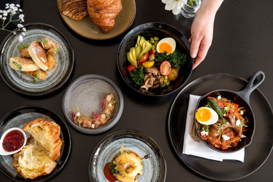 Table of weekend brunch items at Aura Restaurant
